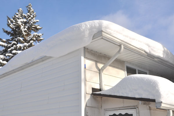 Trop de neige sur le toit? Danger!